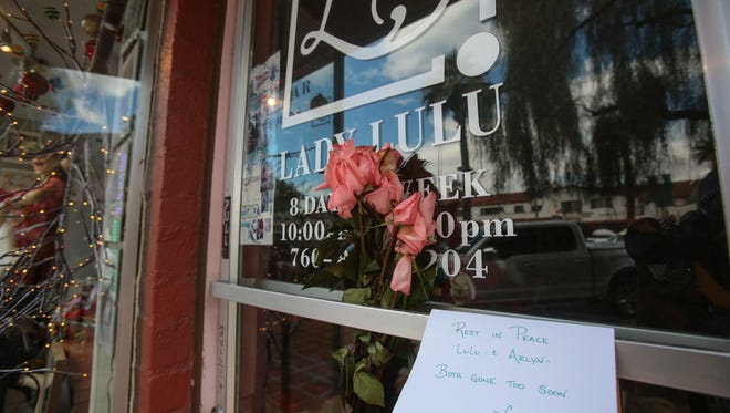 A condolence note and flowers are left on the door of Lady Lulu in Palm Springs on Friday, February 3, 2017. The owner, Gloria Pillay, 58, was killed along with a son, Arlyn Pillay, 35, on January 31, 2017, in an apparent double homicide in Irvine. Another of her sons, Nolan Pillay, 37, is being held in Orange County on suspicion of murder with special circumstances.