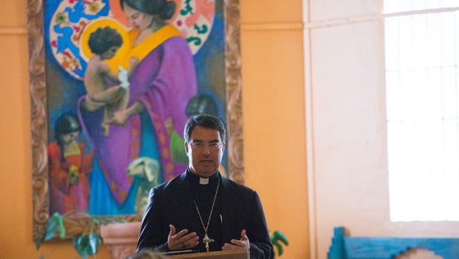 "Catholic Bishop Oscar Cantú opens the interfaith service ""Welcoming the Stranger,"" at St. Albert the Great Newman Center, Friday February 3, 2017. The Service brought together people of different faiths to discuss the new administrations stances toward refugees and have an all inclusive prayer service."