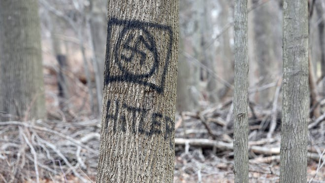 Anti-Semitic graffiti spray painted on a tree in woods located off Cragmere Oval and Cranford Drive in New City, photographed Feb. 3, 2017. The graffiti includes racist and other anti-Semitic markings.