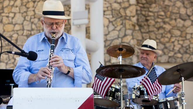 Lance Schulz plays the clarinet during the 20th anniversary Naples Dixieland Jazz Band concert in Cambier Park on Sunday, Feb. 5, 2017.