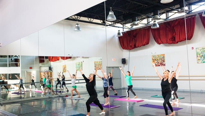 Susan Gregory, 56, teaches a ballet fitness class at Naples Academy of Ballet on Tuesday, Feb. 7, 2017. Gregory trained at the Royal Ballet School in London and worked as a professional dancer until she was 40 years old.