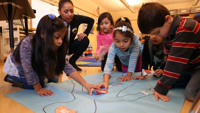 Teacher Frances Carlo works with kindergarteners Dallana Genis, left, Riya Chauhan, Caroline Herrera, Gonzalo Flores and Alexander Nella during an anatomy lesson at Post Road Elementary in White Plains.