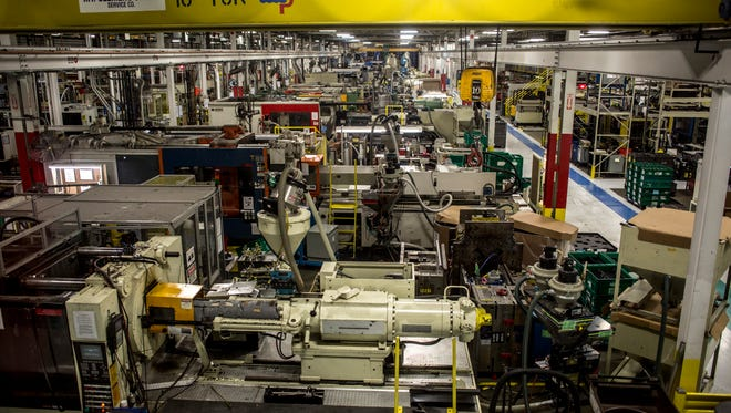 Rows of injection molding machines are seen Thursday, Feb. 9, 2017 at US Farathane Corporation in Port Huron.