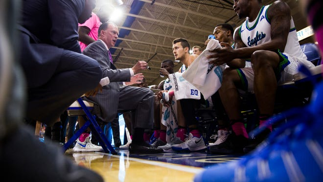 Joe Dooley, head mens basketball coach for Florida Gulf Coast University, talks with his team during a time out during the game against Lipscomb University on Thursday, February 9, 2017 at Alico Arena in Estero.