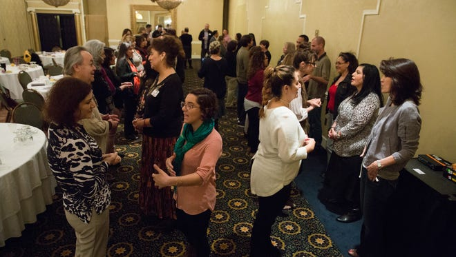 During the first part of Ngage New Mexico's Early Childhood Education Convening at the Ramada Las Cruces hotel and Conference Center on Thursday, Feb. 9, 2017, members of various organizations offering family services for Doña Ana County residents take time to meet each other and network before presentations continued.