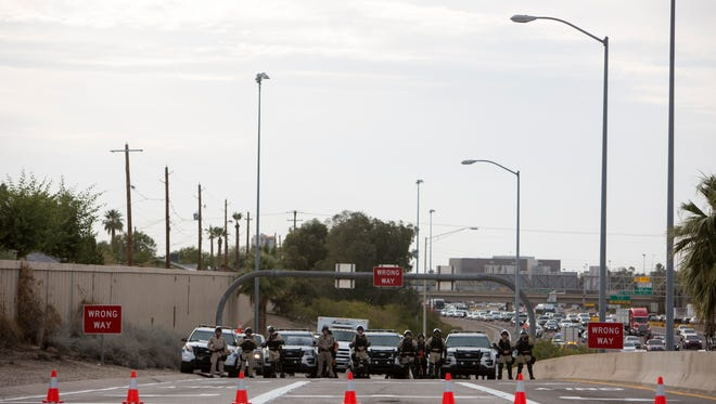 Police block off the Interstate 10 exit from protesters in Phoenix, Ariz. on Feb. 17, 2017.