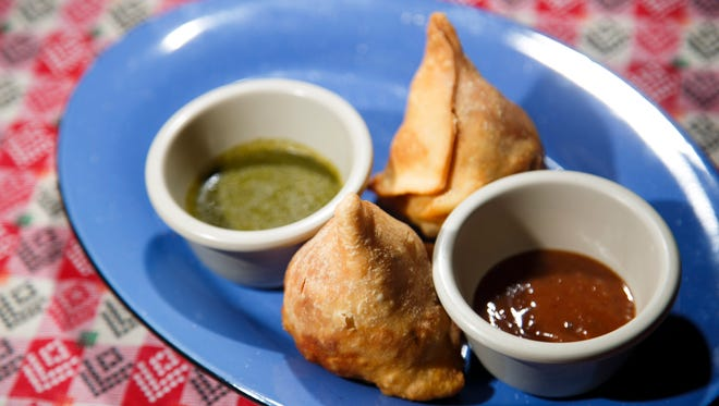 Vegetable samosas with mint and tamarind sauces from Kathmandu Indian and Nepali cuisine Wednesday, Feb. 22, 2017.