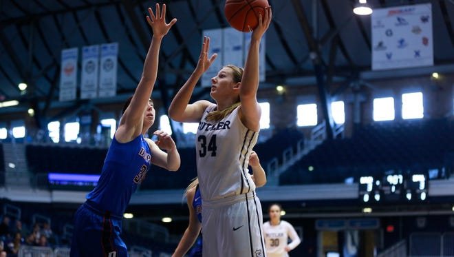 Butler University sophomore Tori Schickel shoots over a DePaul University defender earlier this season. Schickel is a Mater Dei graduate who won two state championships with the Wildcats.
