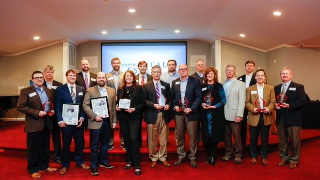 Commercial Real Estate Award winners pose with their hardware at a celebration on Feb. 9 at Bridgewater Place.