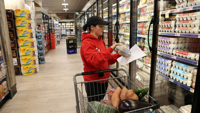 Nicole Mahig, 24, of New Castle shops for groceries at DeCicco & Sons in Millwood, Feb. 23, 2017.