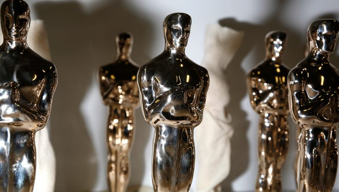 Oscar statuettes wait for inspection before being finished at the Polich Tallix Fine Art Foundry in Rock Tavern, N.Y.