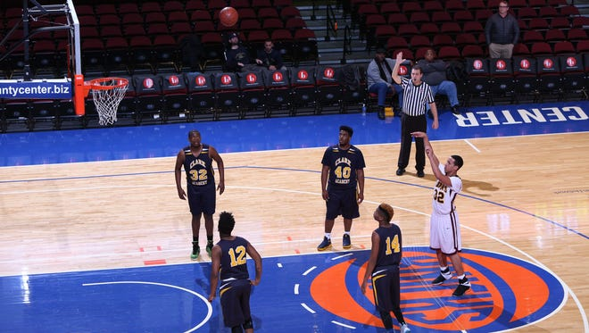 Biondi's Anwar McFadden throws a free throw during the Class D semifinals against Clark at the Westchester County Center, Feb. 27, 2017. Biondi won 67-59.