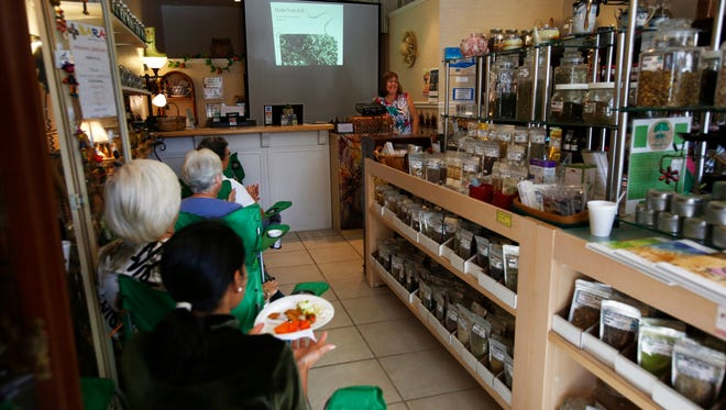 Cathy Via, center right, leads a workshop on Wednesday, March 1, 2017, at her store, Cathy's Herbs and Botanicals, in Naples. Via discussed antioxidants and how to incorporate them into your diet with about eight attendees during the weekly workshop.