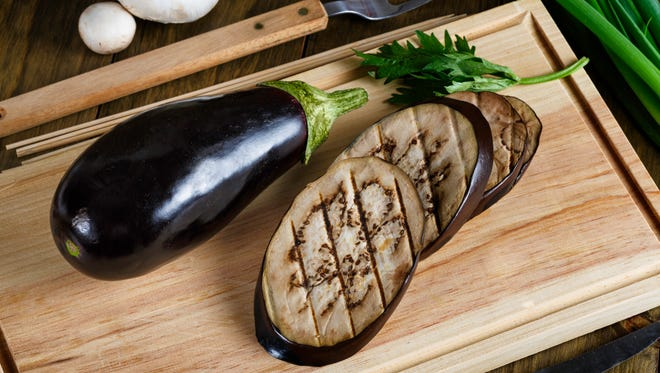 Grilled slices of Eggplant on cutting board. Vegetables are important part of healthy eating and provide a source of many nutrients, including fiber, potassium, folic acid and vitamins A, E and C. Options like spinach, tomatoes, broccoli and garlic provide additional benefits, transforming them in superfood. USDA's MyPlate encourages making half your plate fruits and vegetables.