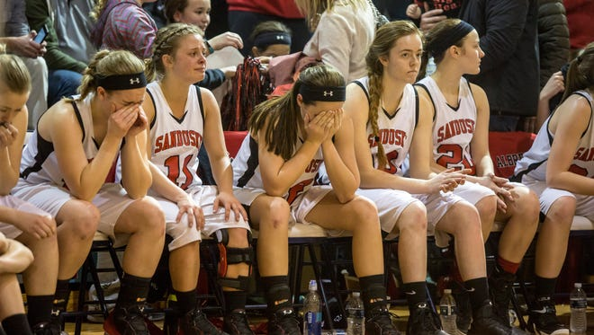 Sandusky players react as they lose to Flint Hamady in a regional final basketball game Thursday, March 9, 2017 at Flint Hamady High School.