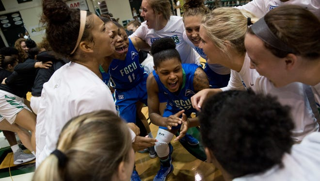 FGCU's Rosemarie Julien, center, pumps up her teammates prior to the Atlantic Sun championship game at the Edmunds Center Sunday, March 12, 2017 in DeLand, Fla.