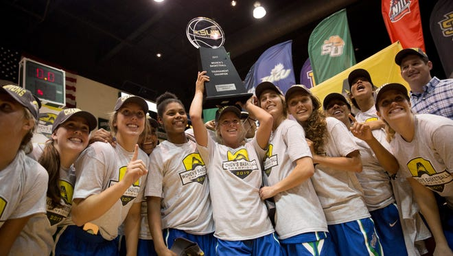 The FGCU women's team hoists the Atlantic Sun championship trophy after defeating Stetson 77-70 in the Atlantic Sun championship game at the Edmunds Center Sunday, March 12, 2017 in DeLand, Fla.