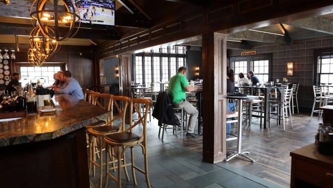 Patrons have lunch at the Mill House Brewing Company brew pub in Poughkeepsie March 9, 2017.