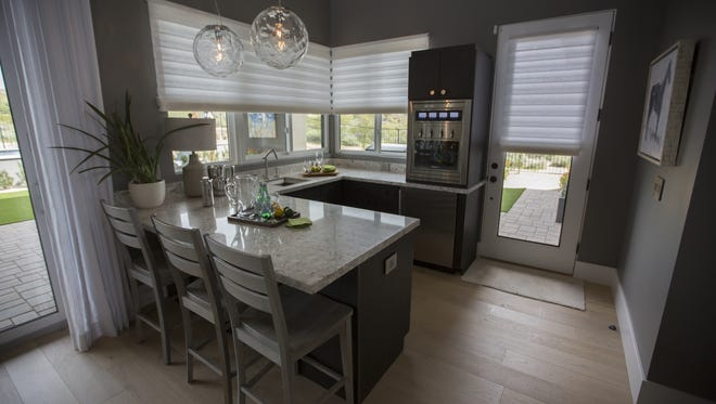 The HGTV Smart Home sits finished in Scottsdale, Ariz. on Mar. 15th, 2017. The smart home is part of a sweepstakes where contestants can win the home, a Mercedes, SUV, and 100,000 dollars. The home has several smart features that control lighting, blinds, toilets, showers, locks and security, amongst other features in the house.
