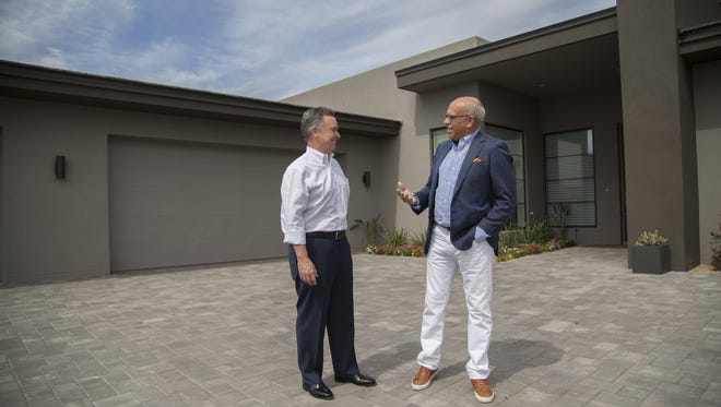 Jim Audiss, (left) the HGTV Smart Home builder, and Mark Candelabra (right) the HGTV Smart Home architect, stand in front of the HGTV Smart Home in Scottsdale, Ariz. on Mar. 15th, 2017. The smart home is part of a sweepstakes where contestants can win the home, a Mercedes, SUV, and 100,000 dollars. The home has several smart features that control lighting, blinds, toilets, showers, locks and security, amongst other features in the house.