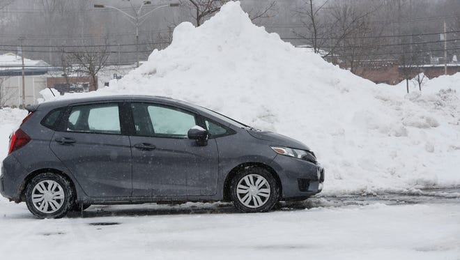 A giant snow mound fills several parking spaces at the BJ's parking log in Yorktown on Mar. 15, 2017.