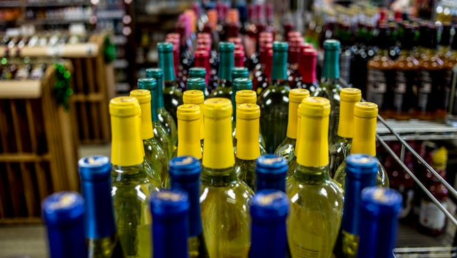 Colorful wine bottles are seen on display at Walsh's Party Store in Marysville. A recent change to the Michigan Liquor Control Code allows gas stations to acquire a liquor license despite quotas of one license per 1,000 people. The city of Marysville has written a letter to the Liquor Control Commission taking a stand against the change, as they feel it could negatively impact locally owned party stores.