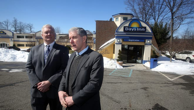 Rockland County District Attorney Thomas Zugibe, right, and County Attorney Thomas Humbach stand outside the Days Inn hotel in Nanuet March 17, 2017 where they announced they had started legal action to try to close down the hotel, which they said has become a notorious haven for illegal drug dealing and prostitution.