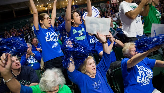 Fans in the FGCU section cheer during the first half of action during a first round NCAA tournament game at the Watsco Center Saturday, March 18, 2017 in Coral Gables, Fla.