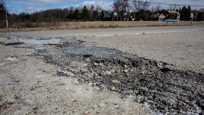 A large pothole is seen in the roadway Wednesday, March 22, 2017 on Fred Moore Highway near King Road. Fred Moore Highway will be reconstructed between Carriage Lane and King Road this year.