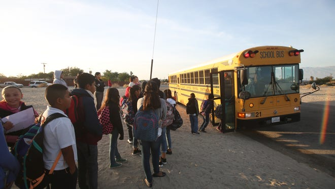 Children in Coachella Valley Unified School District line up to catch a school bus in North Shore in this Desert Sun file photo taken in December 2016.