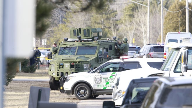 Numerous law enforcement vehicles and SWAT teams respond to shooter Wednesday at an apartment complex on the corner of Aspen Street and Ross Avenue in Weston. A police officer and at least three others were shot.