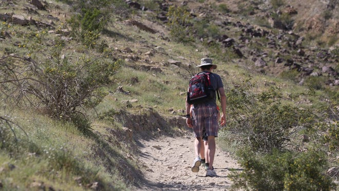 A hiker uses an access path to get to the Bump and Grind trail in Palm Desert. Michael Seeger discusses the beauty of solo hiking in Palm Springs.