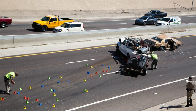 A vehicle plunged onto Interstate 17 near an overpass on Friday afternoon.