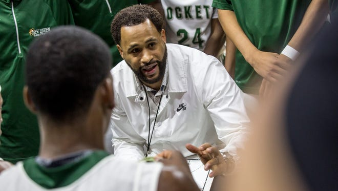 New Haven coach Tedaro France II talks with players in a time out during an MHSAA Class B state basketball final Saturday, March 25, 2017 at Michigan State University.