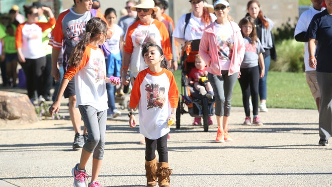 Members of the community participate in a 5K to benefit the Ronald McDonald House Charities of the Inland Empire at La Quinta Civic Center Park on March 24, 2017.