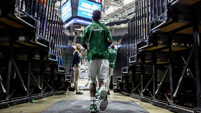New Haven runs out onto the court during an MHSAA Class B state basketball final against Ludington Saturday, March 25, 2017 at Michigan State University.