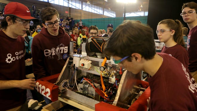Members of the Ossining O-Bots Team 4122 transport their robot after a match at the First Robotics Competition March 26, 2017 at Rockland Community College.