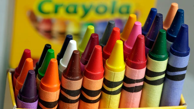 A 24-count box of Crayola crayons are shown, Tuesday, March 28, 2017, in New York. On National Crayon Day, Friday, March 31, Crayola is scheduled to announce the retirement of a color from the pack during an event in New York's Times Square.