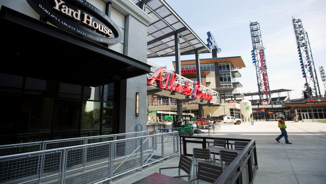 Outdoor seating at a restaurant in the mixed-use area featuring dining options and retail stores sit across from SunTrust Park, the Atlanta Braves' new baseball stadium in Atlanta, Wednesday, March 29, 2017.