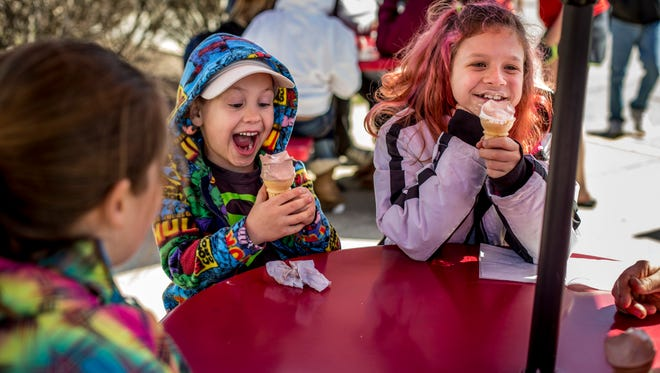 Tyler Duckworth, 5, of Port Huron, can barely contain his excitement as he eats ice cream along with his sister, Ella Duckworth, 10, and others during Free Cone Day Saturday, April 1, 2017 at Jimmy's Frozen Custard in Port Huron.