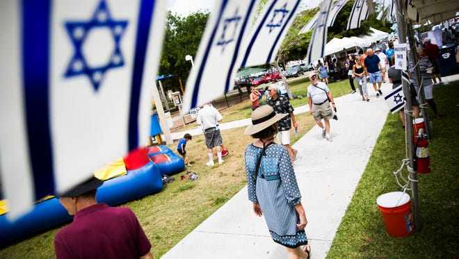 Festivalgoers look at the numerous booths during the Celebration of Israel at Fleischmann Park on Sunday, April 2, 2017, in Naples. The Jewish Federation of Collier County hosted the festival.