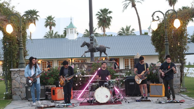 The Tribesmen play at the IOTA HAUS Coachella Valley Fashion Show at the Empire Polo Ground's Rose Garden on March 31, 2017.