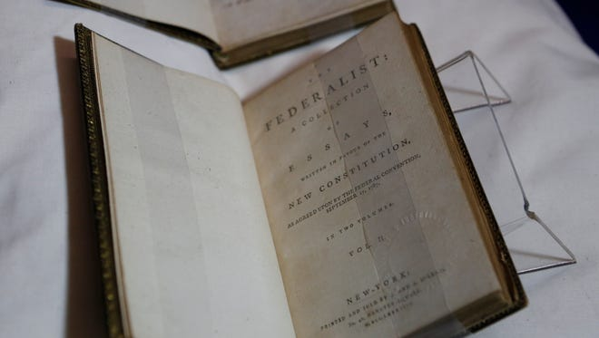 A rare first edition copy of The Federalist is on display at the FDR Presidential Library and Museum in Hyde Park on Apr. 11, 2017.  The chapters, anonymously written, have been attributed to James Madison, John Jay and Alexander Hamilton.  The book was part of over 22,000 owned by President Franklin D. Roosevelt.