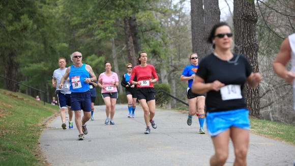 Runners and walkers participate in the 14th annual Conquer a Cove 5K and Health Walk to benefit the nonprofit Hope Chest for Women.