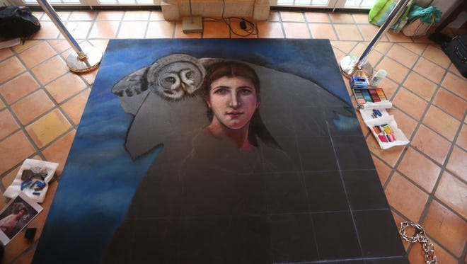 Jane Portaluppi Durand's latest work brings a woman and owl to life on her large tile slab.