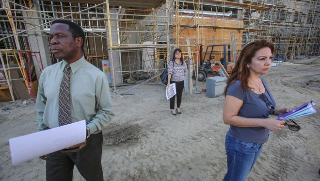 (From the left) Palm Springs city planning staff Edward Robinson, principal planner, Noriko Kikuchi, assistant planner and Terri Hintz, planning administrative coordinator, tour the construction site of the downtown Palm Springs redevelopment project on Thursday, April 13, 2017.