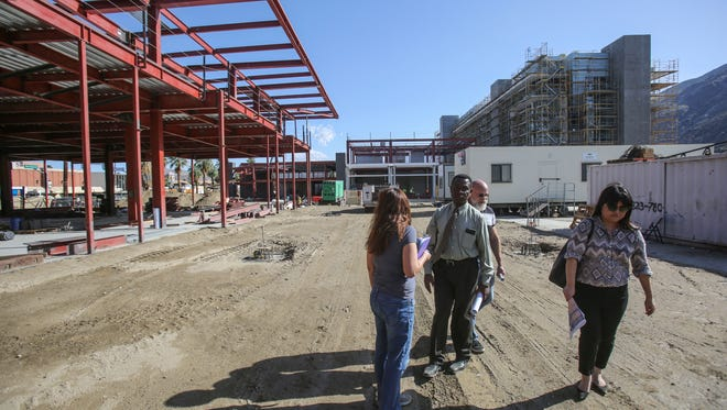 Members of the City of Palm Springs Planning Department on a tour of the construction site of the downtown Palm Springs redevelopment project on Thursday, April 13, 2017.