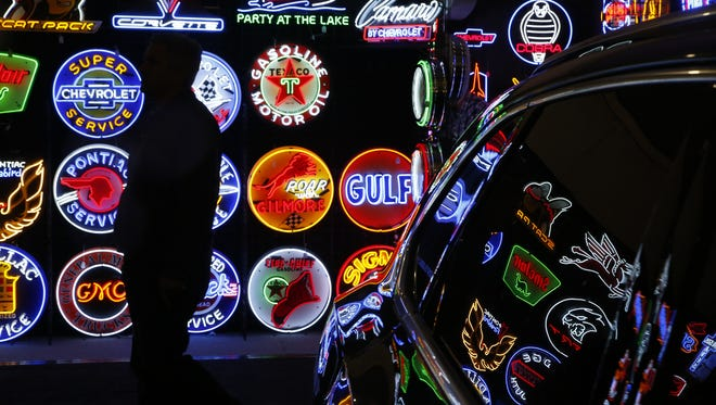 Neon lit signs show off a variety of car-related memorabilia  at Barrett-Jackson on January 22, 2017 at West World in Scottsdale, Ariz.