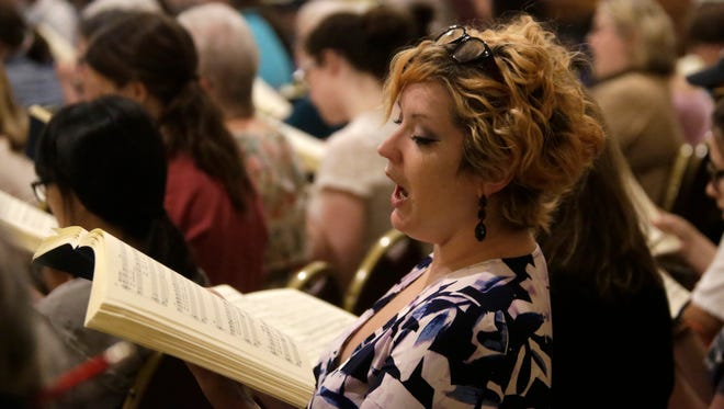 Melissa Kuder rehearses Bach's St. John Passion with the rest of the Tallahassee Community Chorus at St. John's Episcopal Church April 10 in preparation for their Evening of Bach concert April 30.