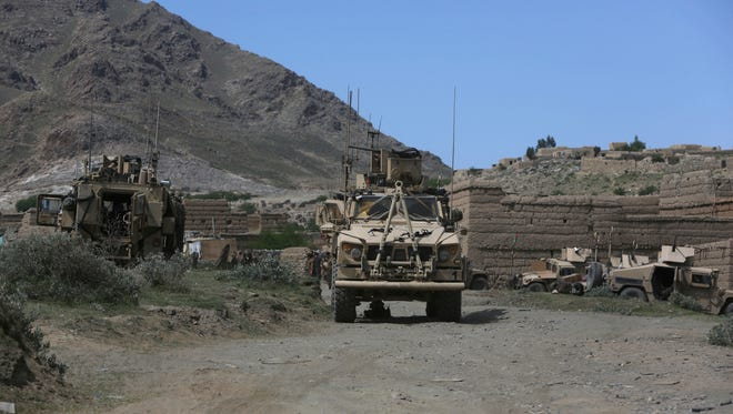 U.S. forces and Afghan commandos are pictured in Asad Khil near the site of a U.S. bombing in the Achin district of Jalalabad, east of Kabul, Afghanistan.